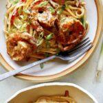 Overhead image of two bowls of cajun shrimp pasta.