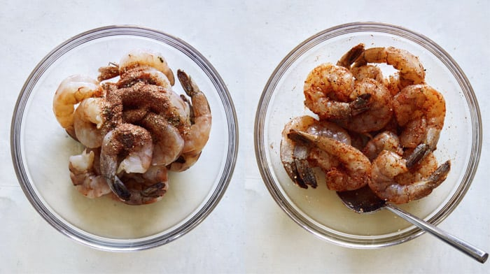 Shrimp in a bowl mixed with seasoning.