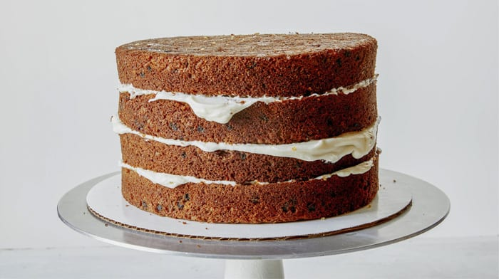 Carrot cake with frosting in between the layers.