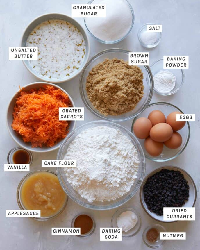 Ingredients for carrot cake on a kitchen counter.