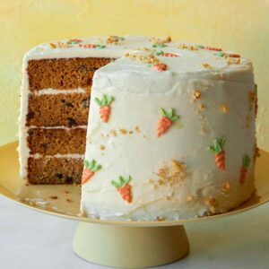 Carrot cake recipe on a cake stand.