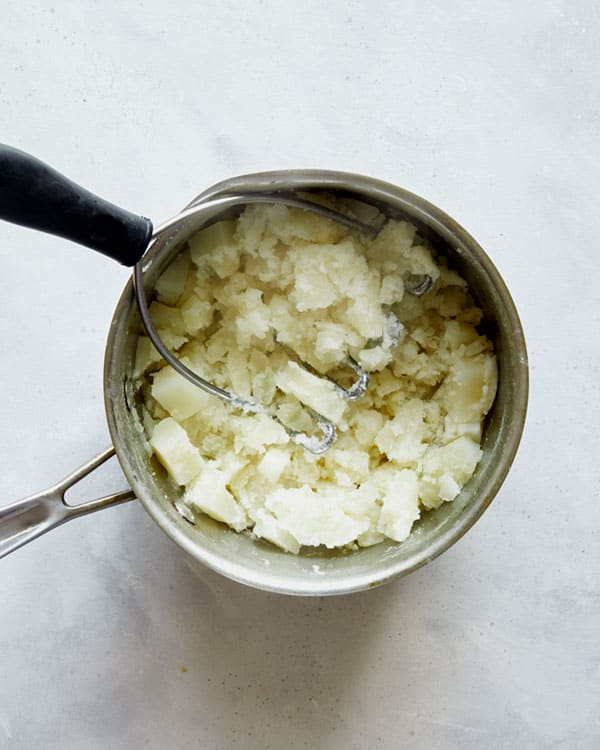 Mashed potatoes in a pot to make Browned Butter Colcannon.