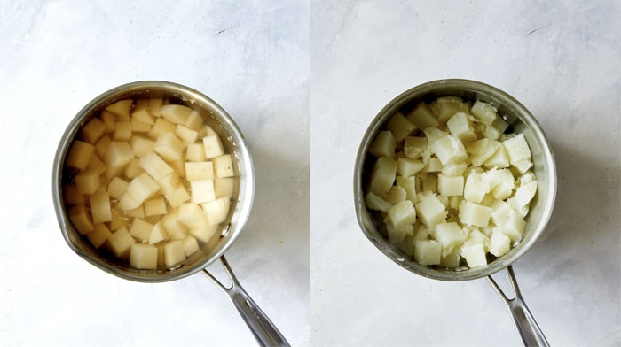 Cooked potatoes in a pot to make Colcannon.