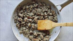 Cooking breakfast sausage in a skillet.