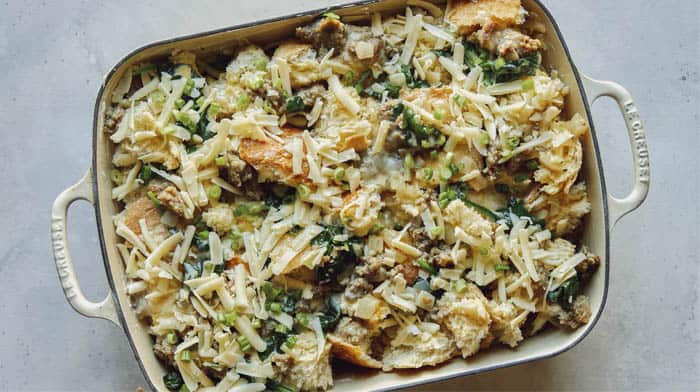 A completed sausage strata recipe in a baking dish ready to be baked.