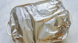 Sausage strata wrapped in foil to be baked.