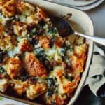 Sausage strata recipe in a baking dish with a scoop out.