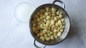 Pasta for stovetop mac and cheese in a colander drained.