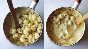 Stovetop mac and cheese in a skillet with wooden spoon.