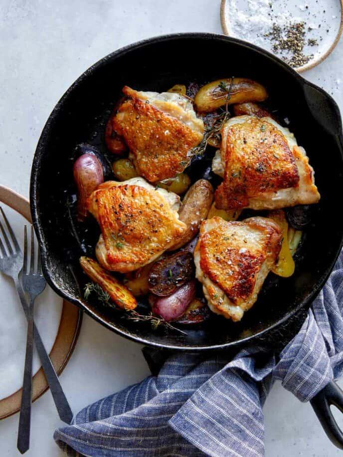 Crispy chicken thighs recipe in a skillet.