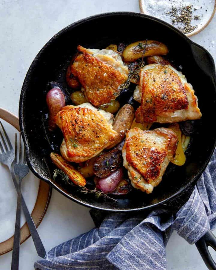 Crispy chicken thighs recipe in a skillet.