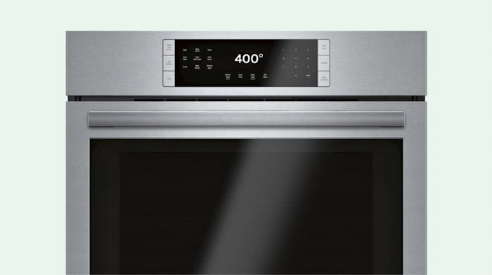 Preheating an oven to 400 degrees.