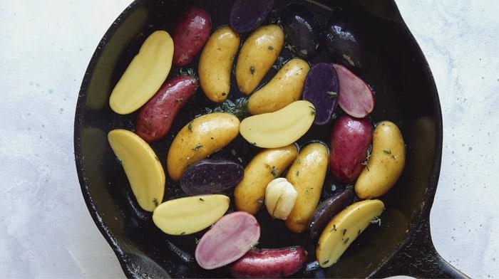 Fingerling potatoes in a skillet.