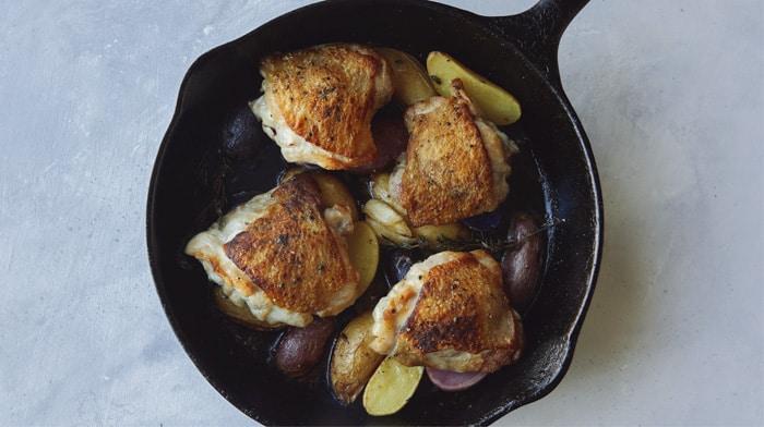 Crispy chicken thigh recipe in a skillet.