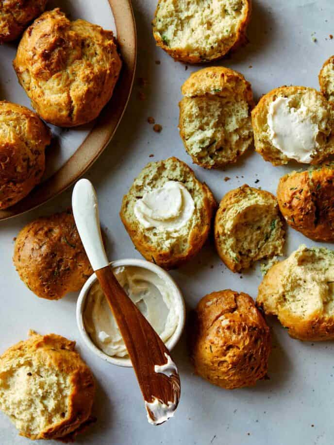 Sour cream and chive drop biscuits with some open served with butter.