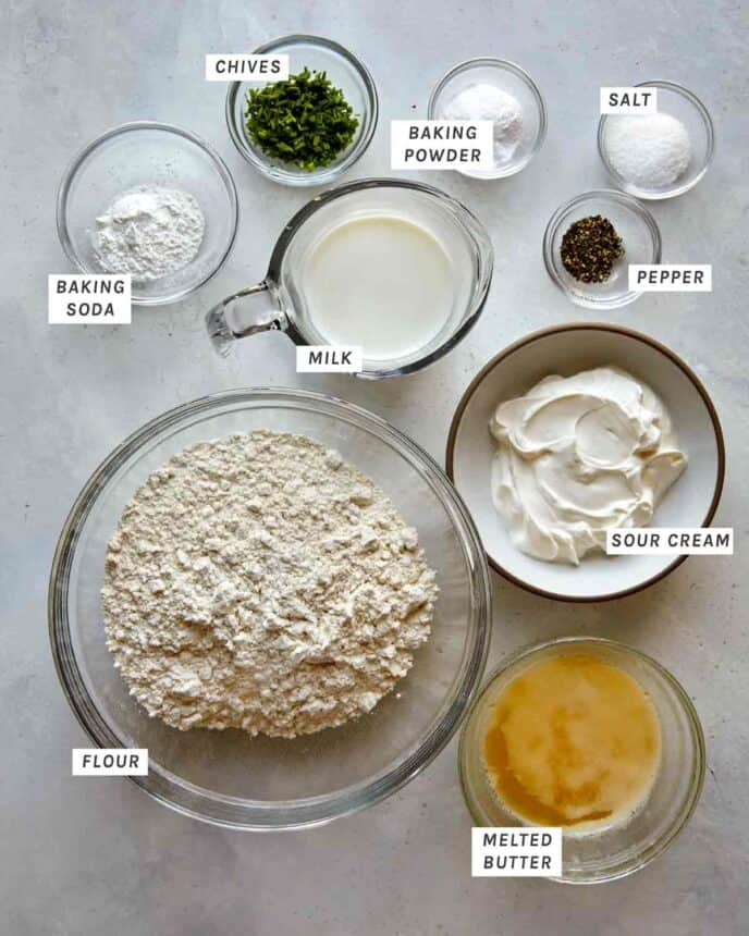 Ingredients for sour cream and chive drop biscuit recipe on a counter.