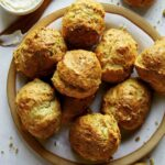 A recipe for drop biscuits on a plate.