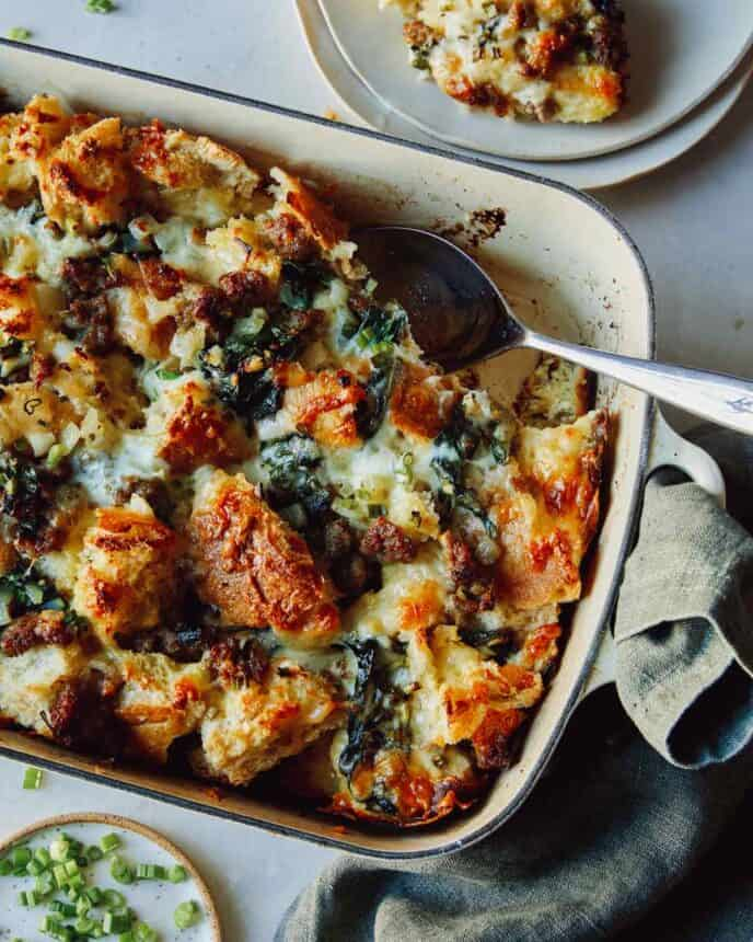 Sausage strata recipe in a dish with a scoop out.
