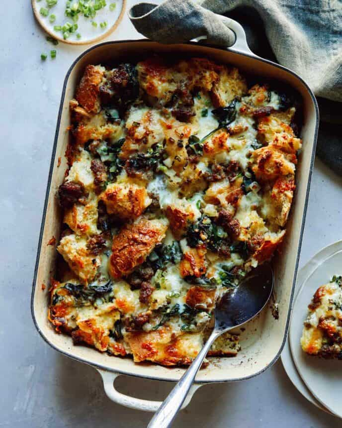 Sausage strata recipe being served onto plates.