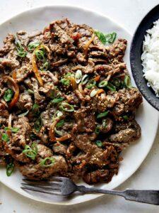 Beef bulgogi recipe on a plate with rice.
