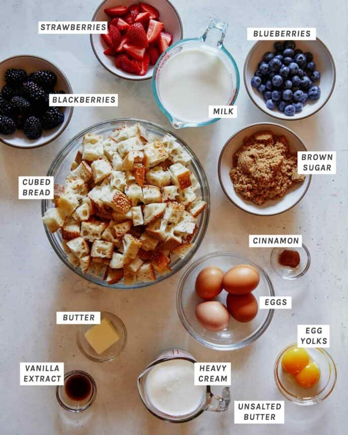 Ingredients to make bread pudding with berries.