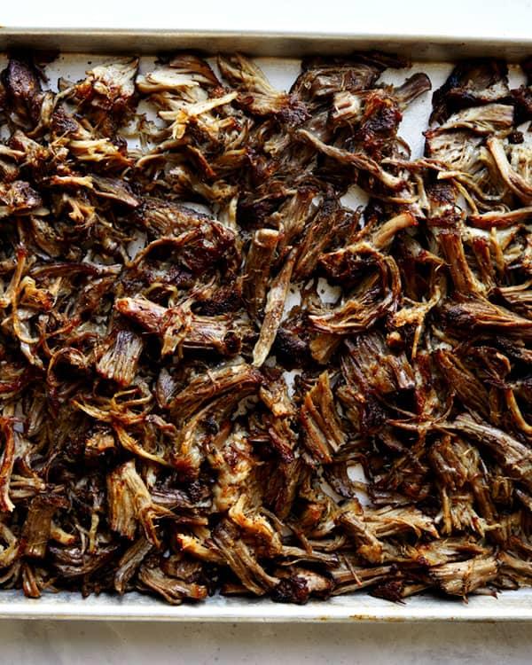 Carnitas on a baking sheet baked.