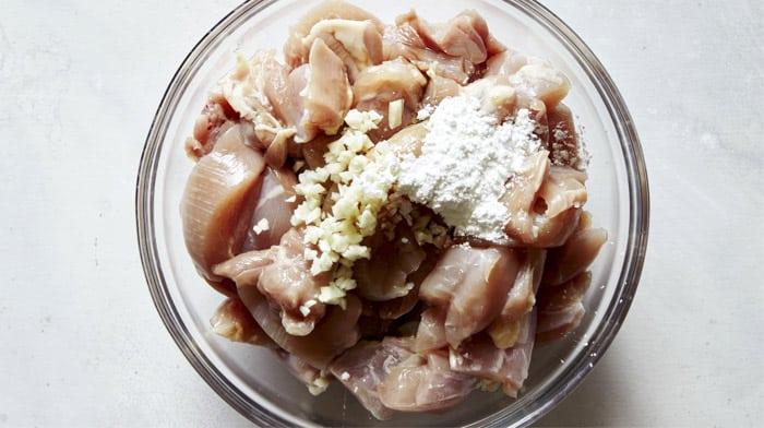 Marinating chicken for honey garlic chicken recipe.