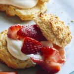 Close up on a strawberry shortcake with whipped cream.