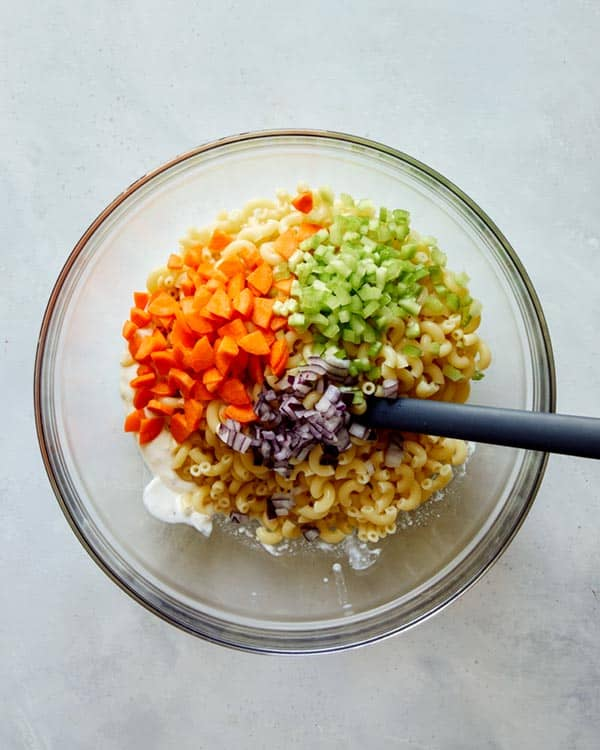 Hawaiian style macaroni salad ingredients in a bowl.