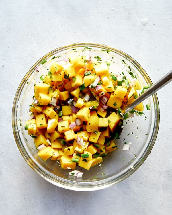 Mango salsa ingredients in a bowl mixed together.