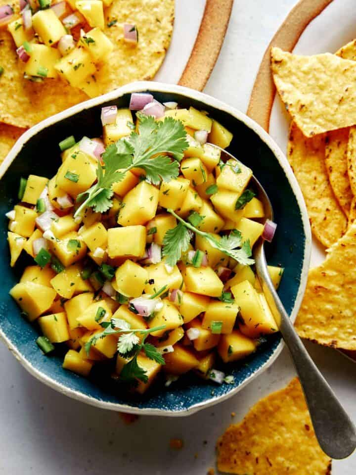 Mango salsa in a bowl with chips.