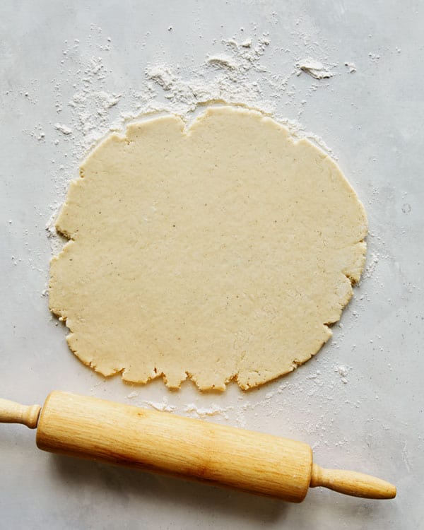 Old fashioned donut dough being rolled out.