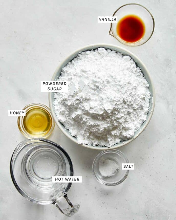 Ingredients to make a vanilla glaze for old fashioned donuts.