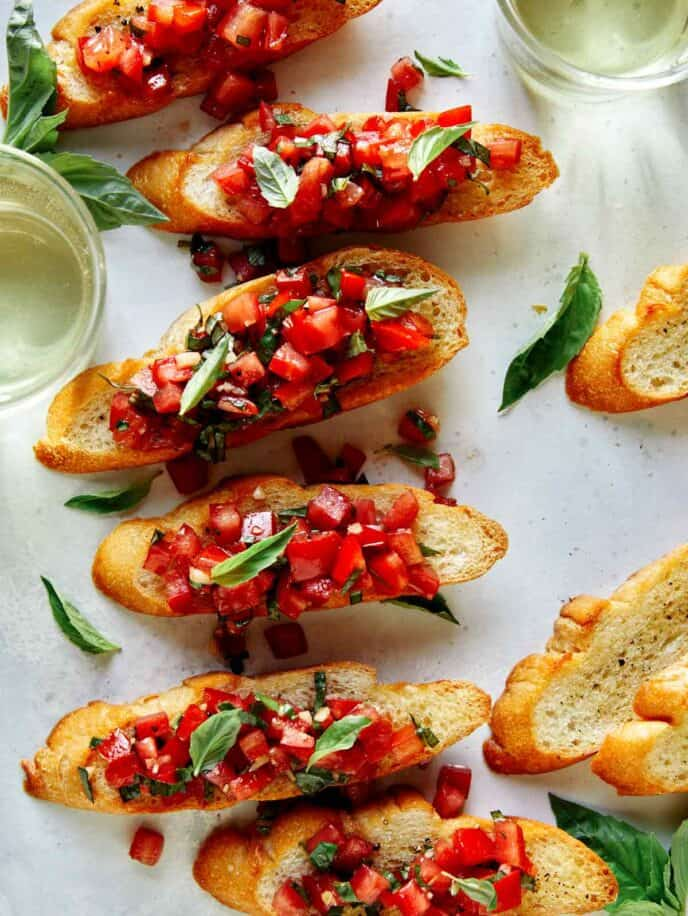 Bruschetta on toasted baguette with wine on the side.