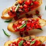 Bruschetta recipe on toasted crostini close up.