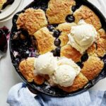 Blueberry cobbler recipe with a scoop taken out.