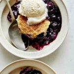 Blueberry cobbler recipe served into two bowls.