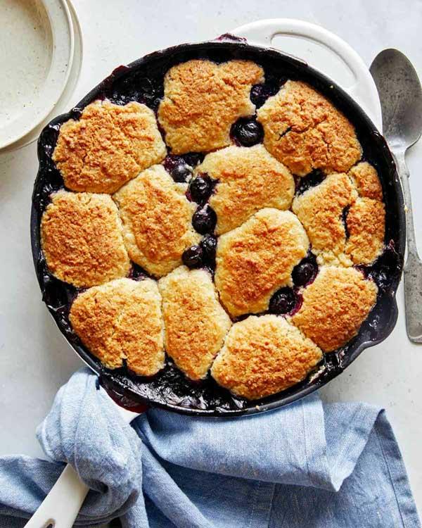 Blueberry cobbler in a skillet freshly baked.
