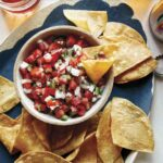 Pico de gallo recipe with chips and beer.