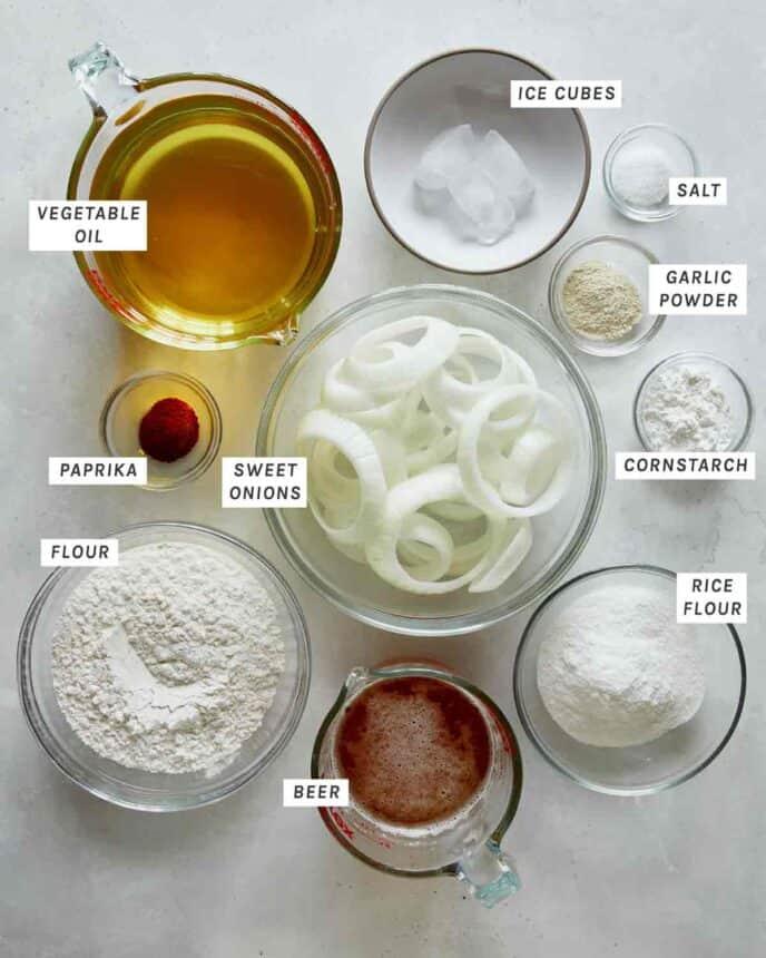 Ingredients to make beer battered onion rings.