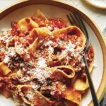 Bolognese sauce recipe in a bowl with a fork.