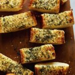 Freshly made garlic bread cut up and ready to be served.