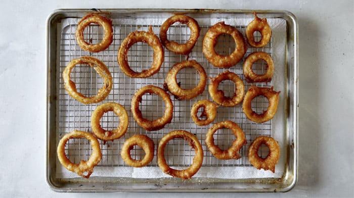 Freshly fried beer battered onion rings.