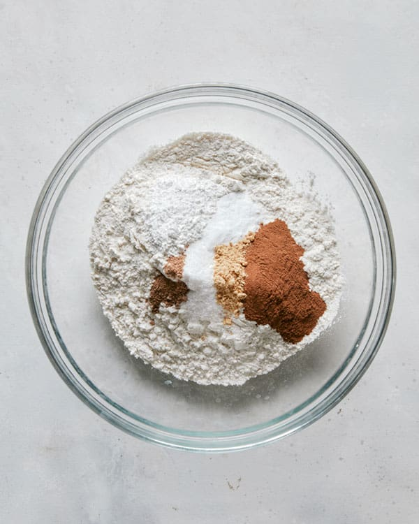 Dry ingredients in a glass bowl to make pumpkin bars.