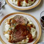 Roast beef recipe with red wine and mashed potatoes.