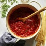 Arrabiata sauce in a stock pot.