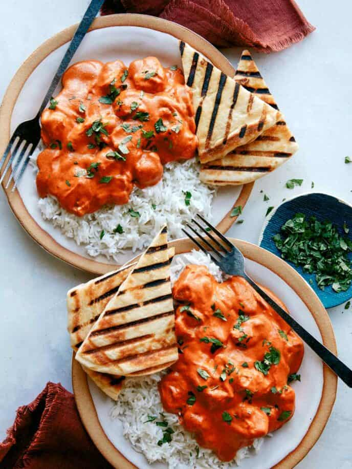 Murgh makhani, or butter chicken recipe made and served on two plates.