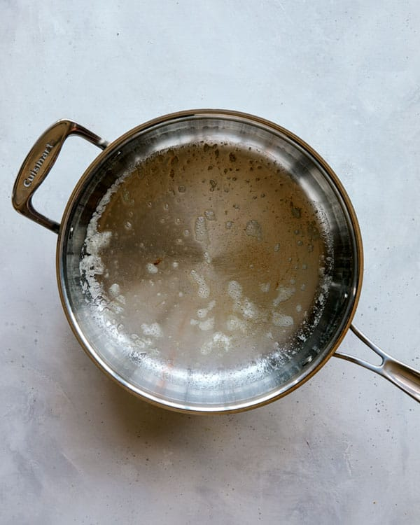 Skillet with melted butter to make butter chicken.