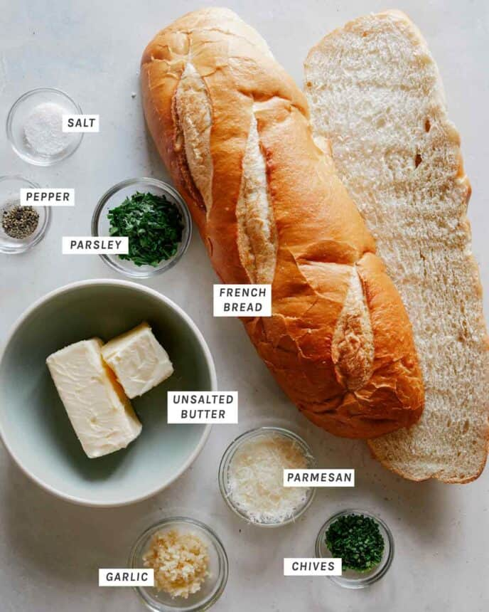 Ingredients to make garlic bread all laid out.