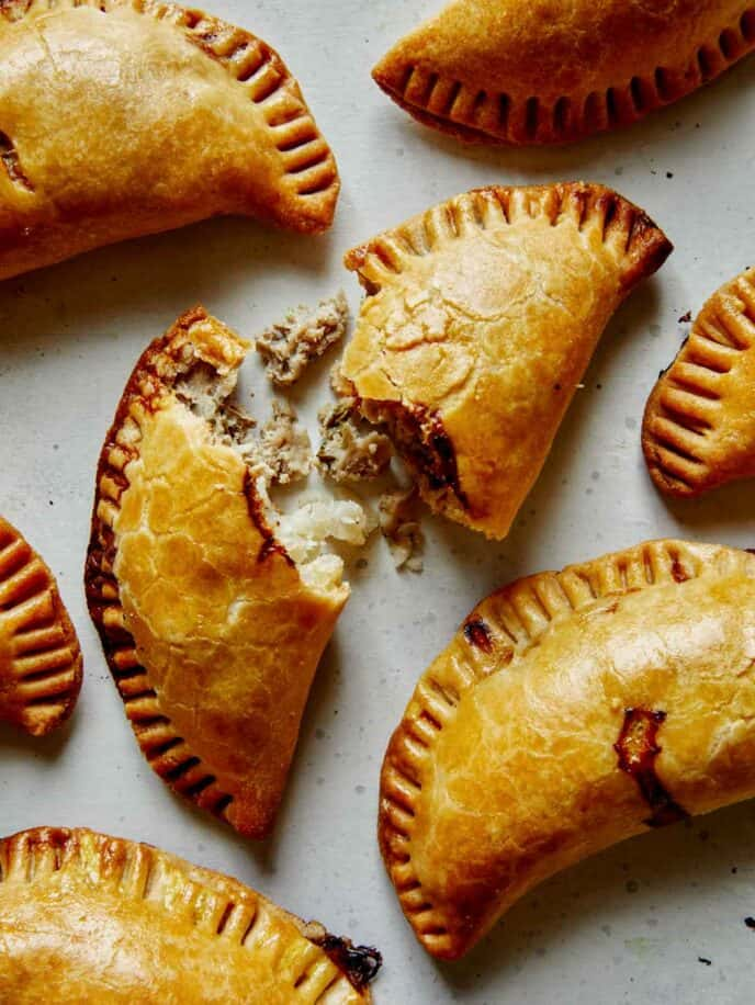 Pork pastie recipe with one torn open.